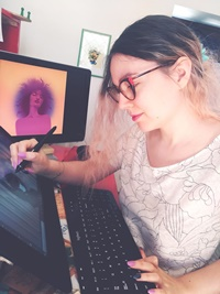 Illustratrice e fumettista Ariel Vittori al lavoro sul poster del numero 56, il numero pride